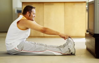 side profile of a mid adult man exercising on the floor